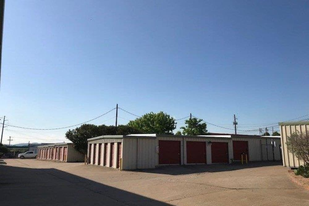 Outdoor storage units with large driveway at Store It All Self Storage - Westlake in Austin, Texas