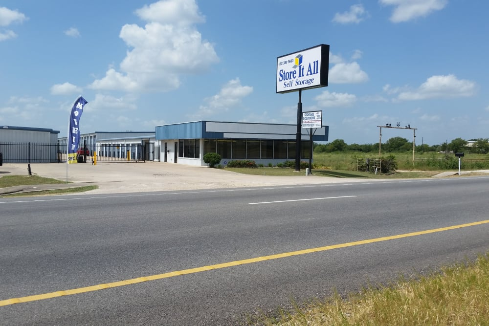 The sign in front of Store It All Self Storage in Del Valle, Texas