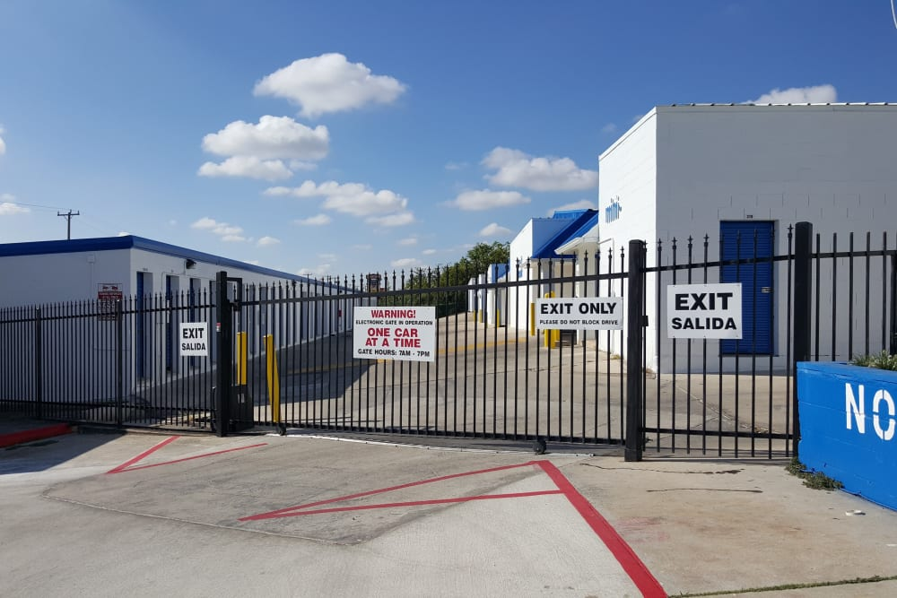 A security gate in front of Store It All Self Storage - McMullen in San Antonio, Texas