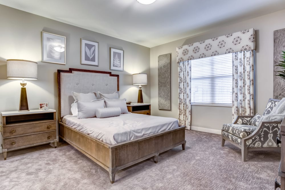 A decorated model bedroom at The Oaks at Byron Center in Byron Center, Michigan.