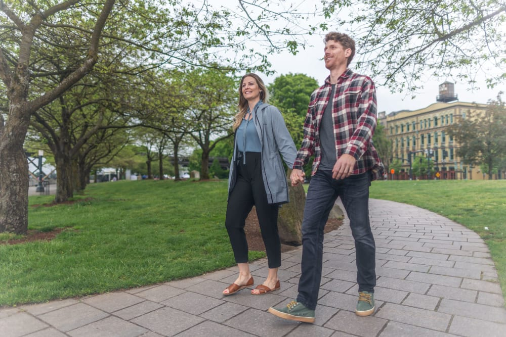 Residents enjoying a stroll in the park near TwentyTwenty Apartments in Portland, Oregon
