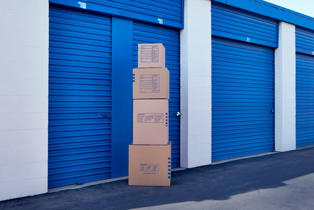 Storage boxes stacked on top of each other outside of a storage unit at Stor'em Self Storage in San Marcos, California