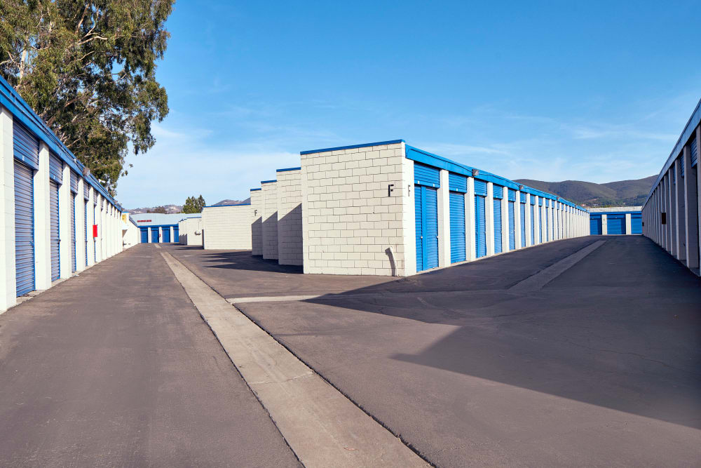 Outdoor storage units with a large driveway at Stor'em Self Storage in San Marcos, California