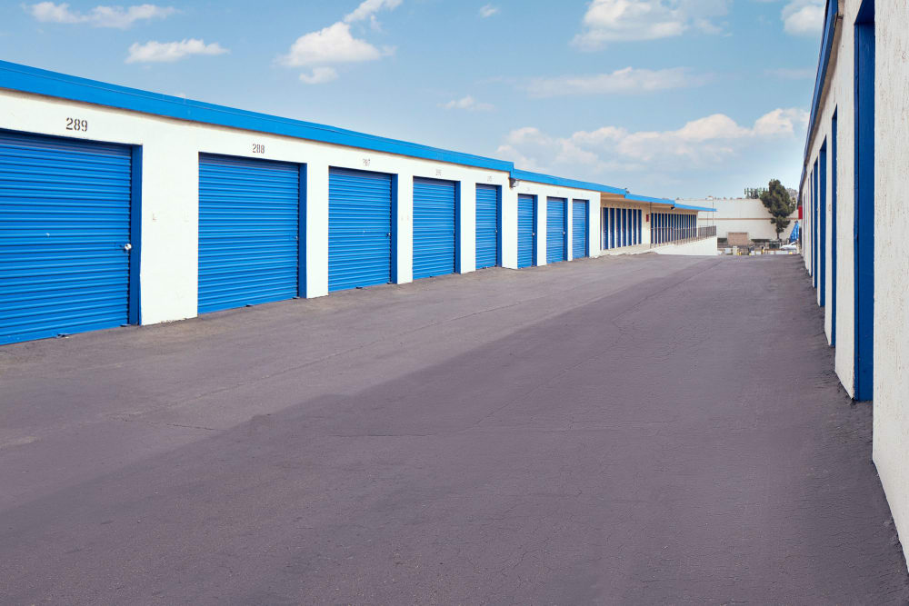 A large driveway with storage units on either side at Stor'em Self Storage in Chula Vista, California