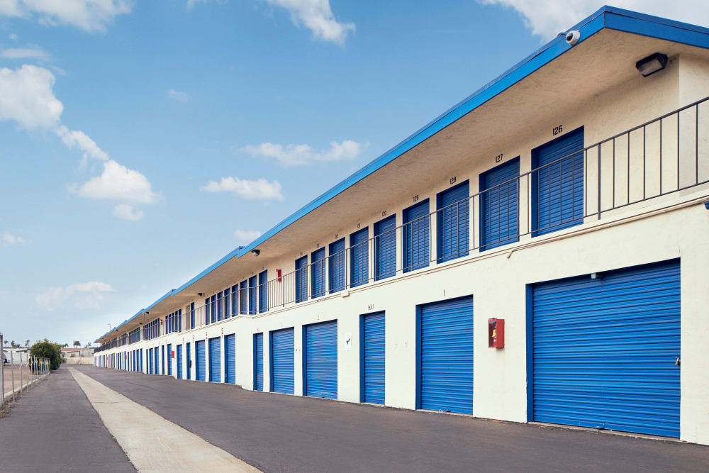 A large, two story building with storage units at Stor'em Self Storage in Chula Vista, California