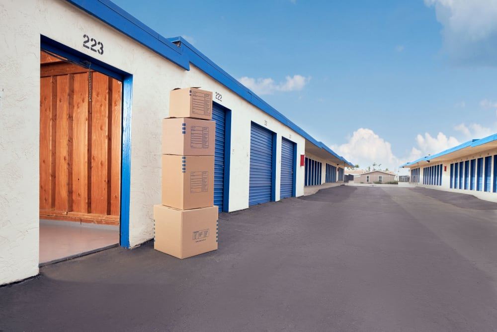 Boxes stacked on top of each other in front of some storage units at Stor'em Self Storage in Chula Vista, California