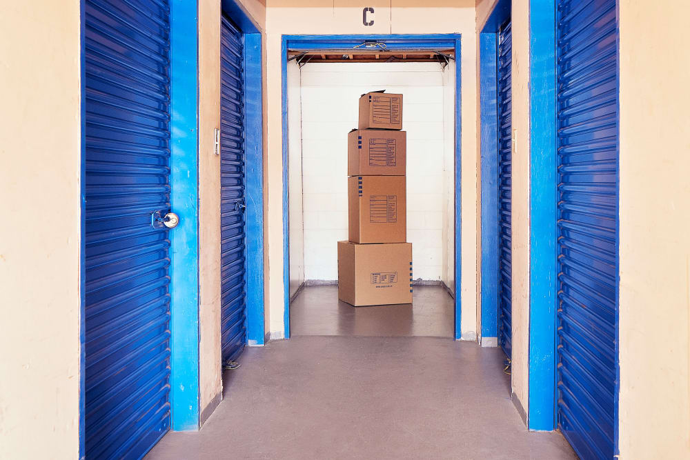 Boxes stacked on top of each other inside of a storage unit at Stor'em Self Storage in Chula Vista, California