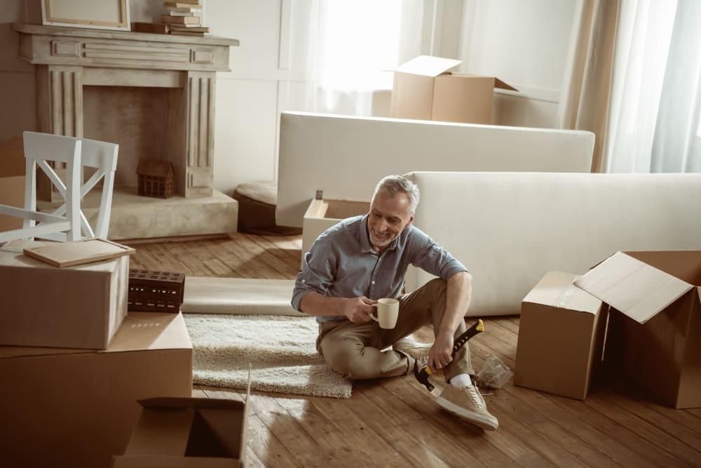A customer unpacking his items he had stored at AAA Self Storage at Pleasant Ridge Rd in Greensboro, North Carolina.