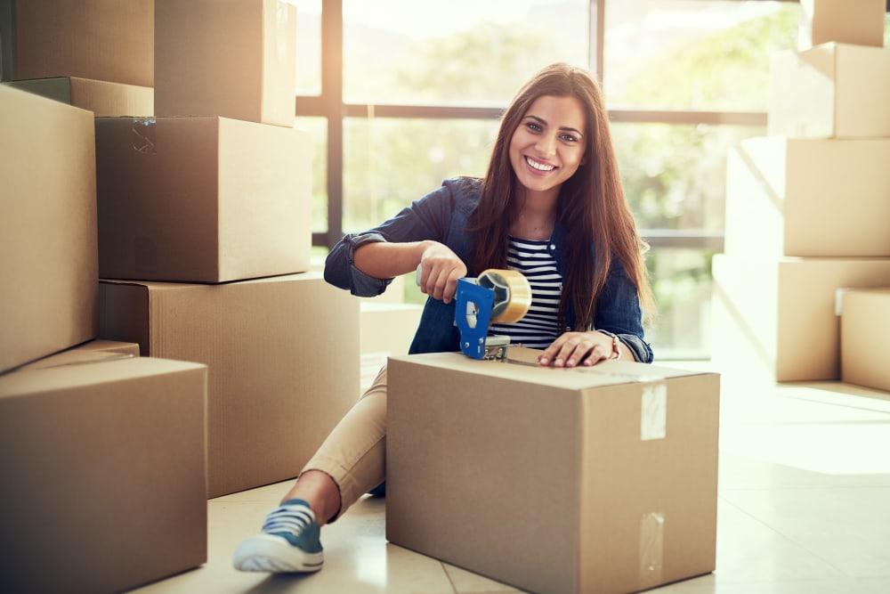 A customer packing up her belongings for AAA Self Storage at Pleasant Ridge Rd in Greensboro, North Carolina.