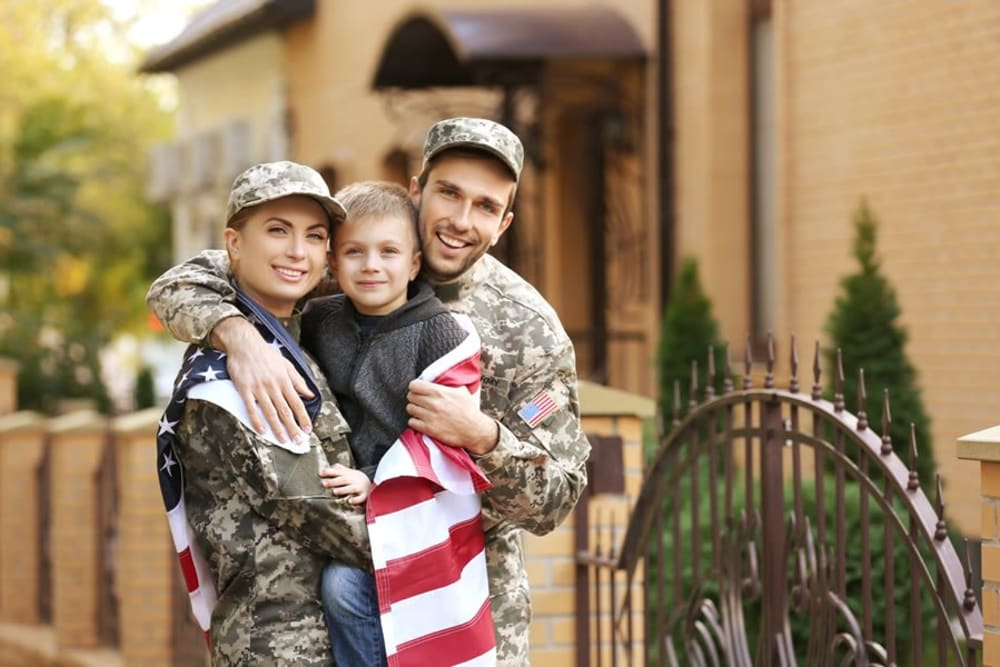 veteran couple and child