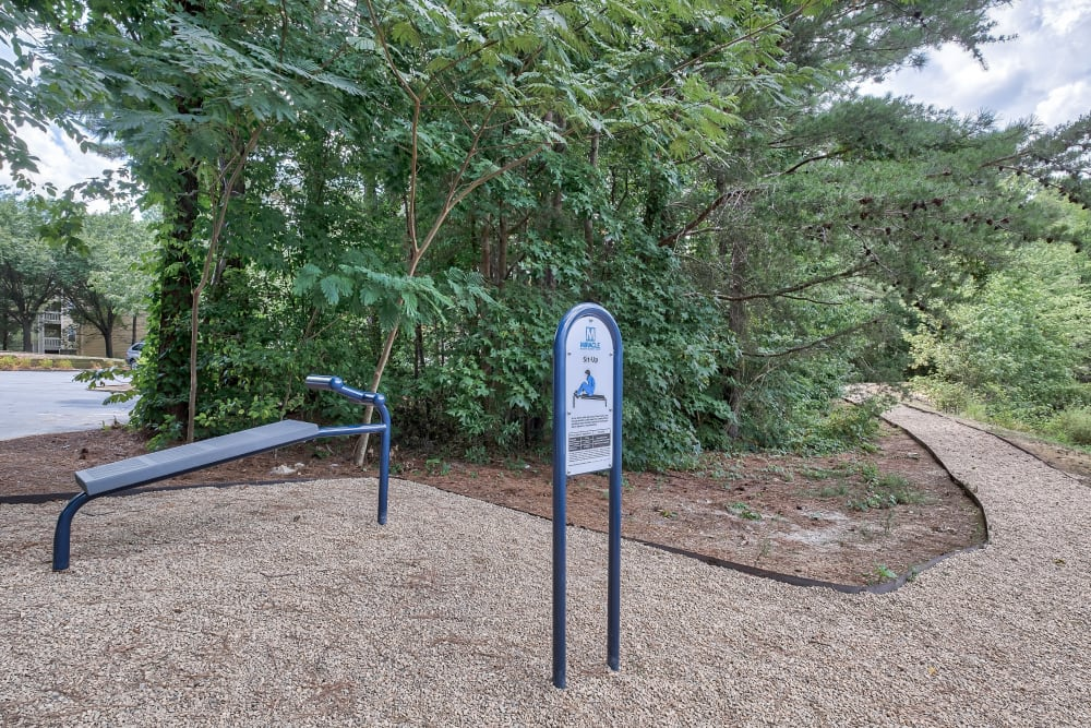 Outdoor fitness station and trail at Copper Mill Apartments