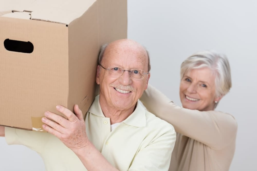Couple moving a storage box