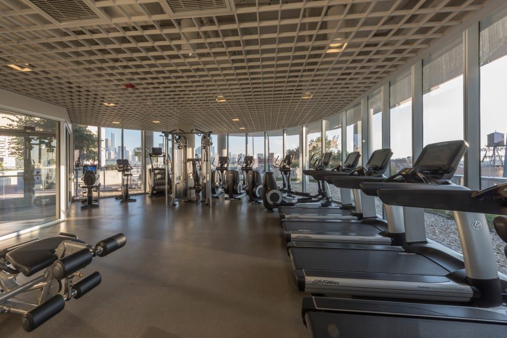 Large fitness center with plenty of workout stations at The Residences at NEWCITY in Chicago, Illinois