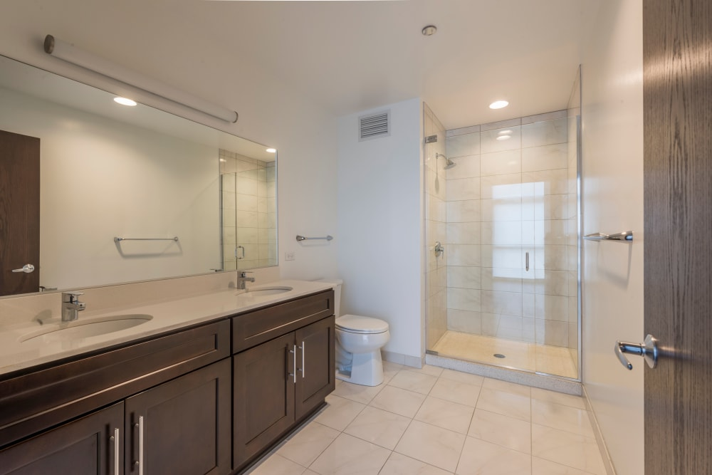 Large master bathroom with duel sinks at The Residences at NEWCITY in Chicago, Illinois