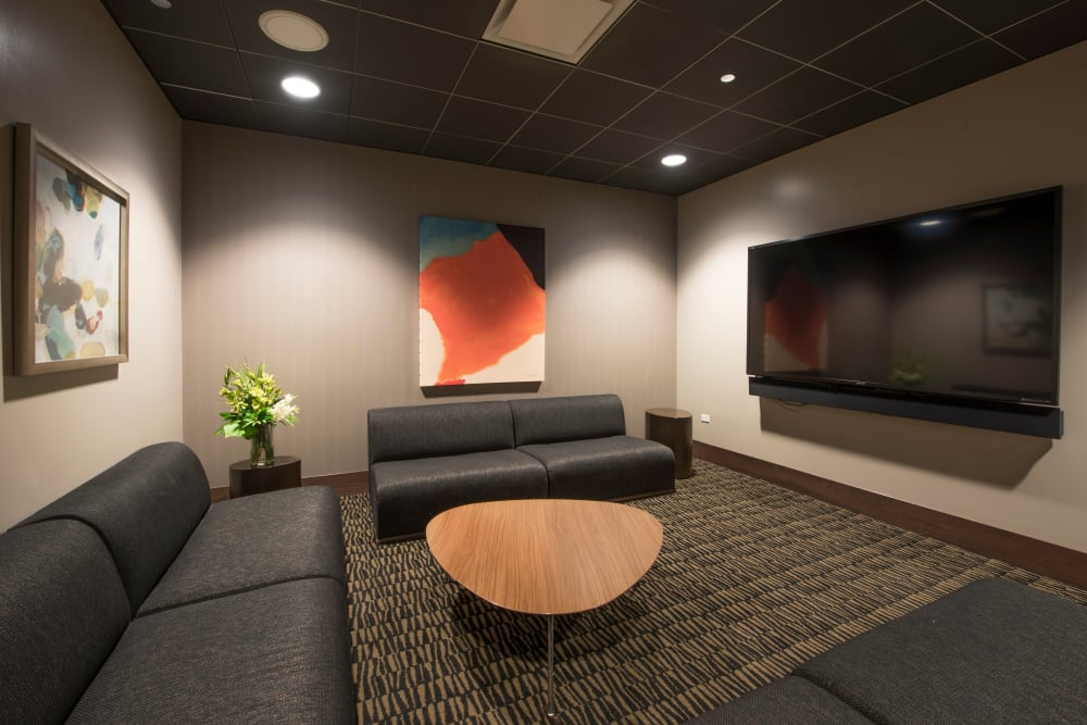 Theater room with couches at The Residences at NEWCITY in Chicago, Illinois