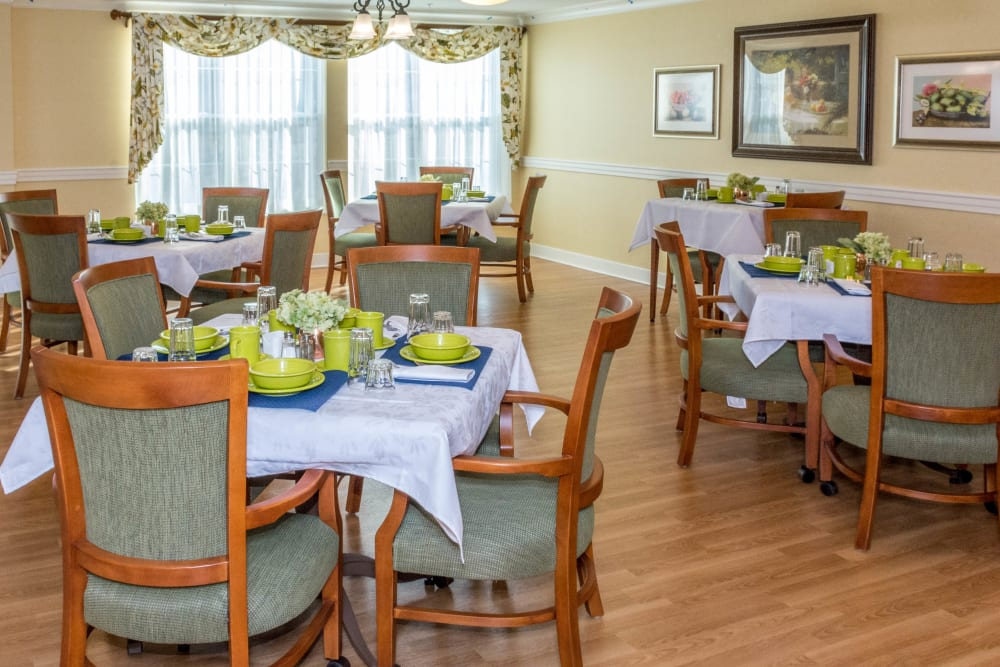 Dining room tables at Artis Senior Living of Commack in Commack, New York