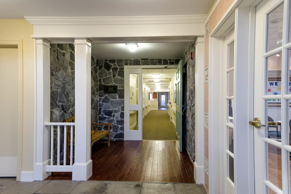 Hallway to dining room at Artis Senior Living of Commack in Commack, New York