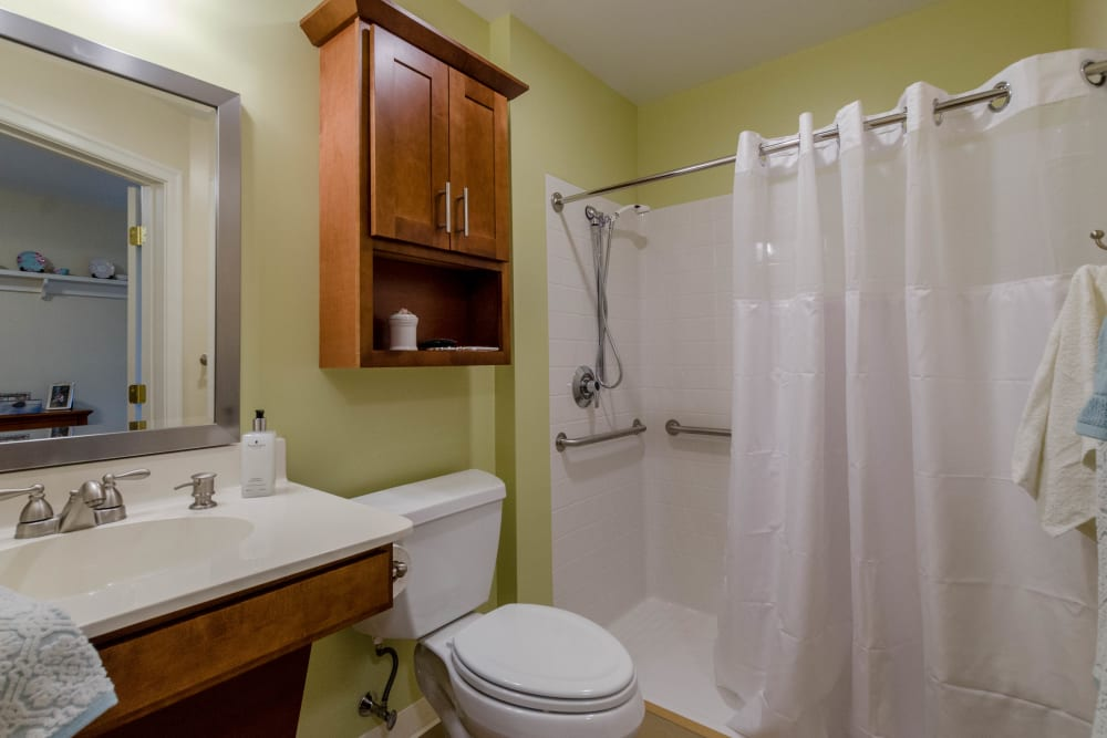 Bathroom and shower at Artis Senior Living of Commack in Commack, New York