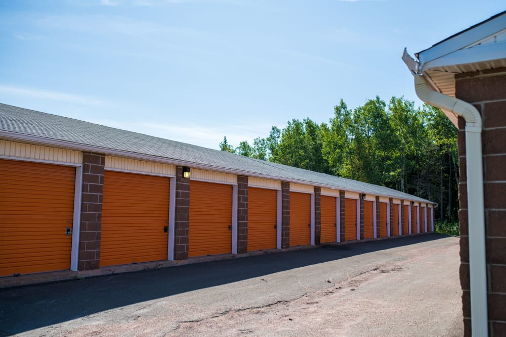 Orange doors on outside units at Apple Self Storage - Dieppe in Dieppe, New Brunswick