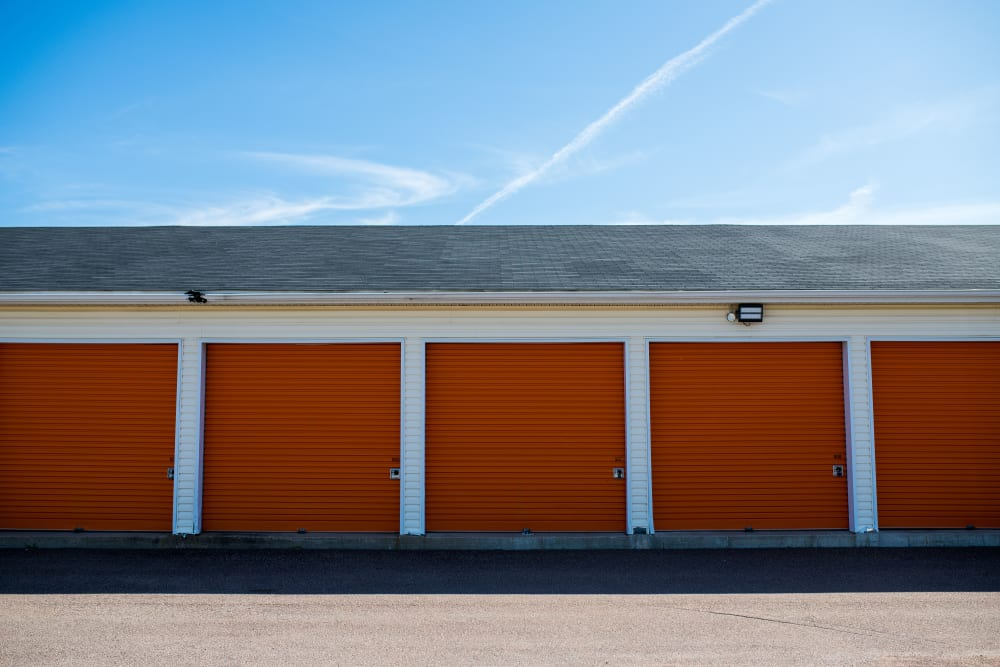 Orange doors on exterior units at Apple Self Storage - Dieppe in Dieppe, New Brunswick