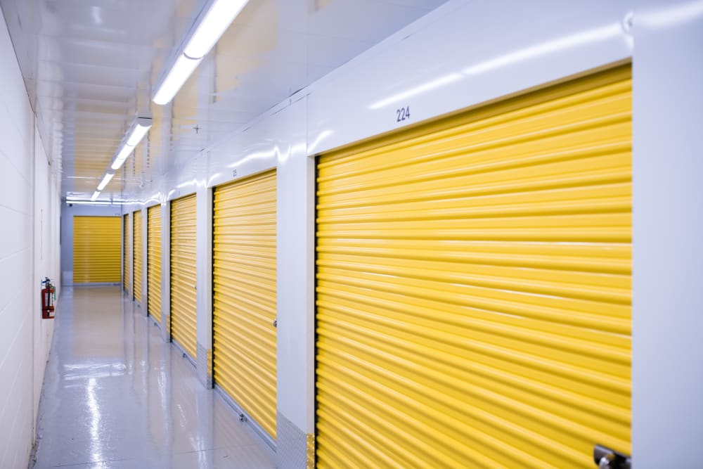 Large, yellow storage unit doors at National Self Storage in Kitchener, Ontario