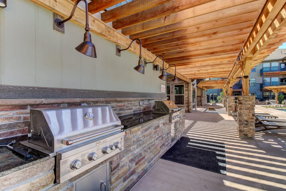 Outdoor BBQ Area at Timnath Trail at Riverbend Apartment Homes in Timnath, Colorado