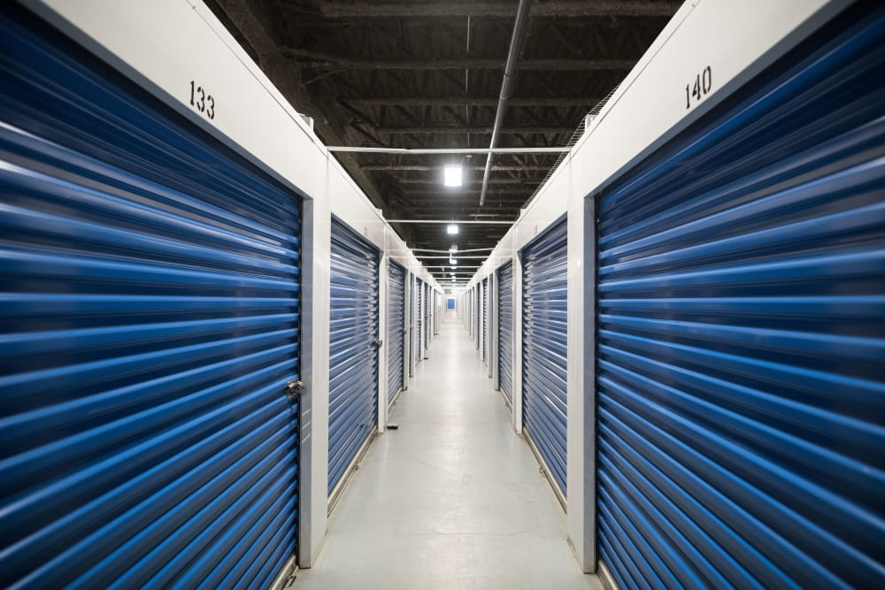 Blue interior storage unit doors at Apple Self Storage - Mississauga East in Mississauga, Ontario