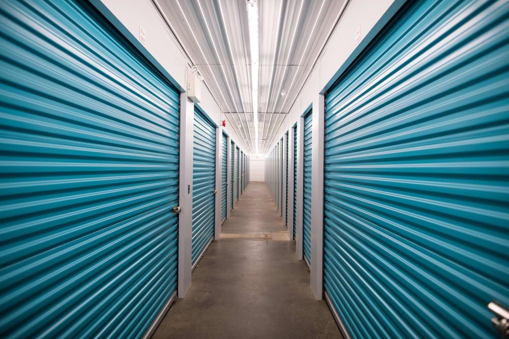 Teal doors on units at Apple Self Storage - Waterloo in Waterloo, Ontario