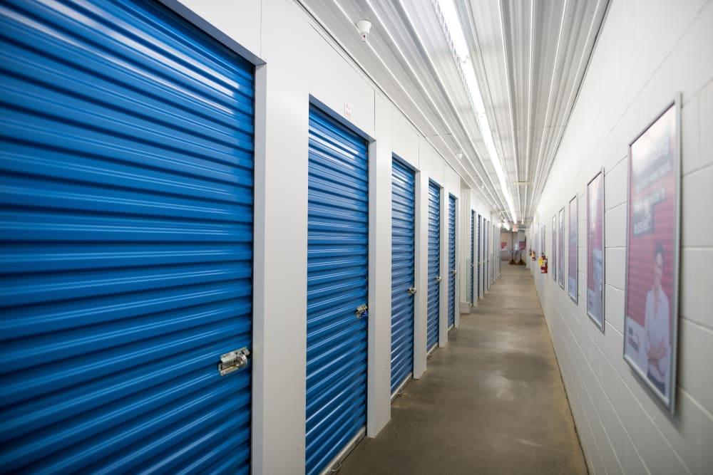 Interior units with blue doors at Apple Self Storage - Waterloo in Waterloo, Ontario