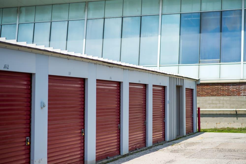 Red doors on storage units at Apple Self Storage - Toronto - Danforth in Toronto, Ontario