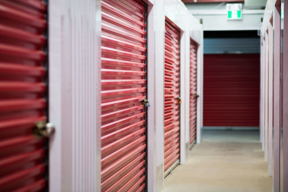 Interior units with bright red doors at Apple Self Storage - Saint John East in Saint John, New Brunswick