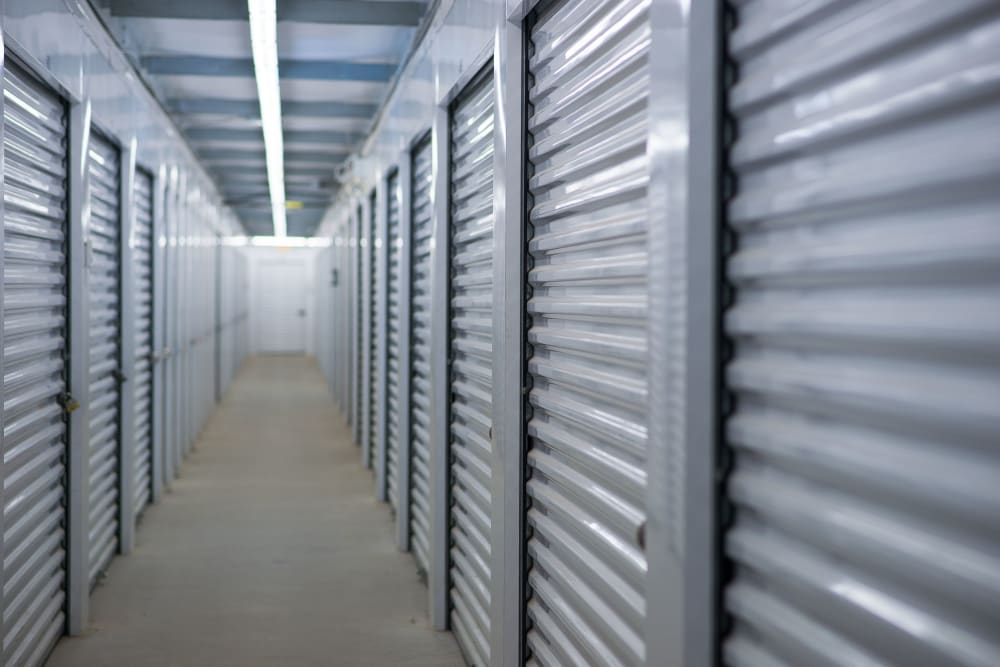 Bright and white interior unit doors at Apple Self Storage - Saint John East in Saint John, New Brunswick
