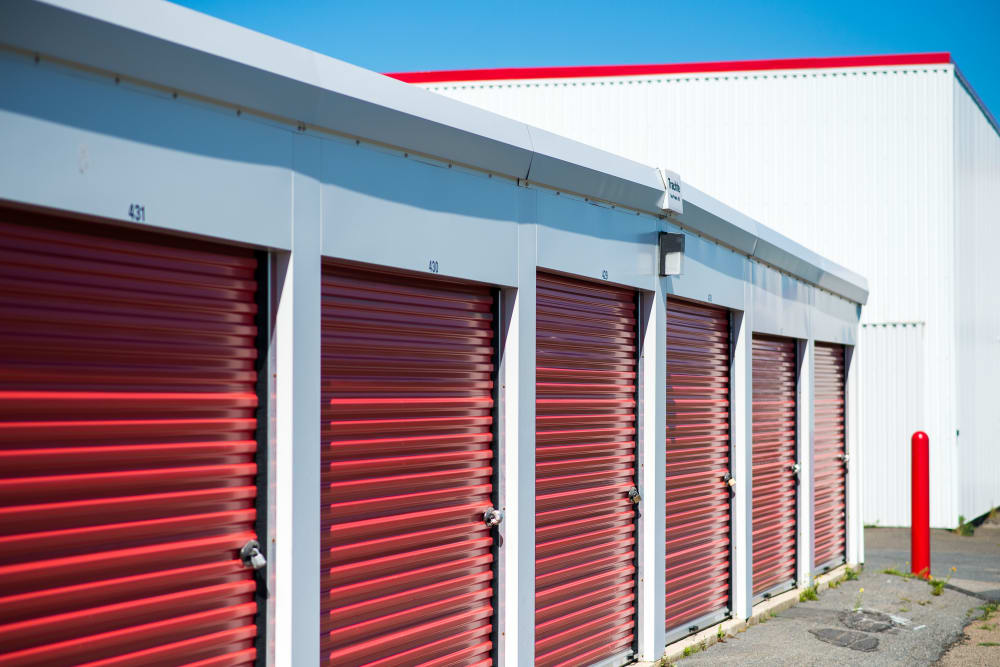 Large red doors on the units at Apple Self Storage - Saint John East in Saint John, New Brunswick