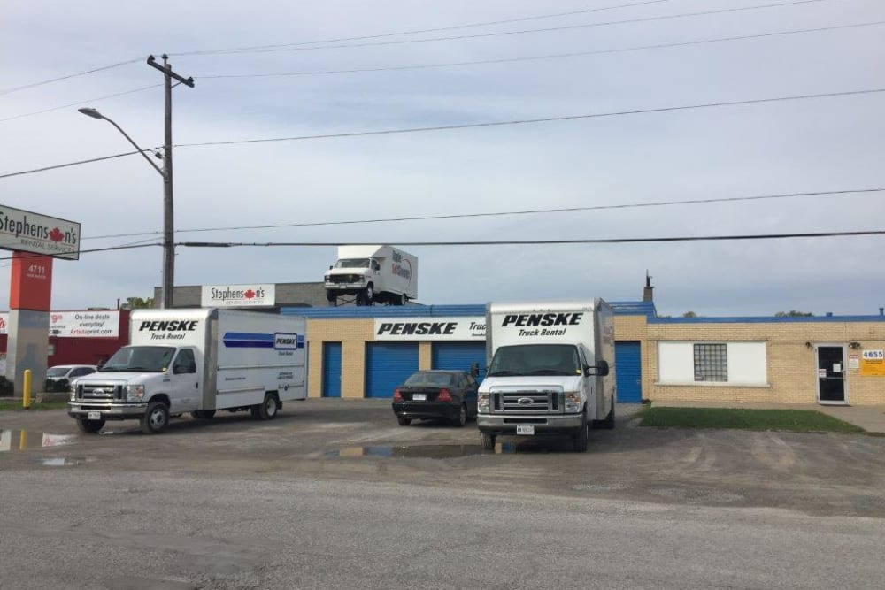 Trucks outside of Apple Self Storage - Niagara Falls - Oakwood in Niagara Falls, Ontario