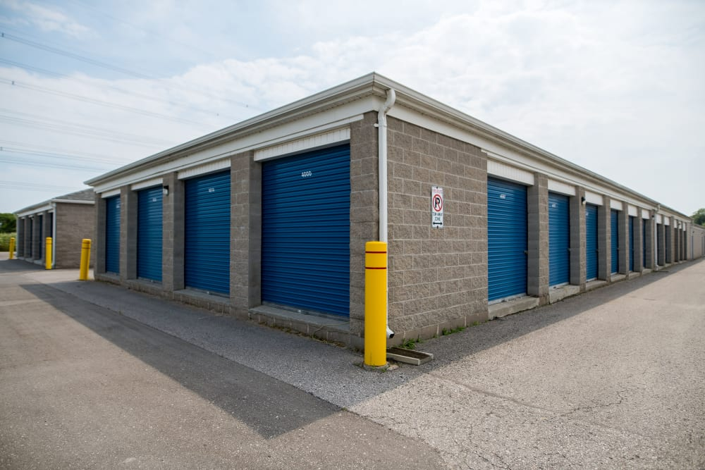Apple Self Storage - Bowmanville in Bowmanville, Ontario, blue exterior storage unit doors