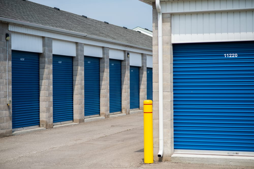 Bright blue storage unit doors at Apple Self Storage - Bowmanville in Bowmanville, Ontario