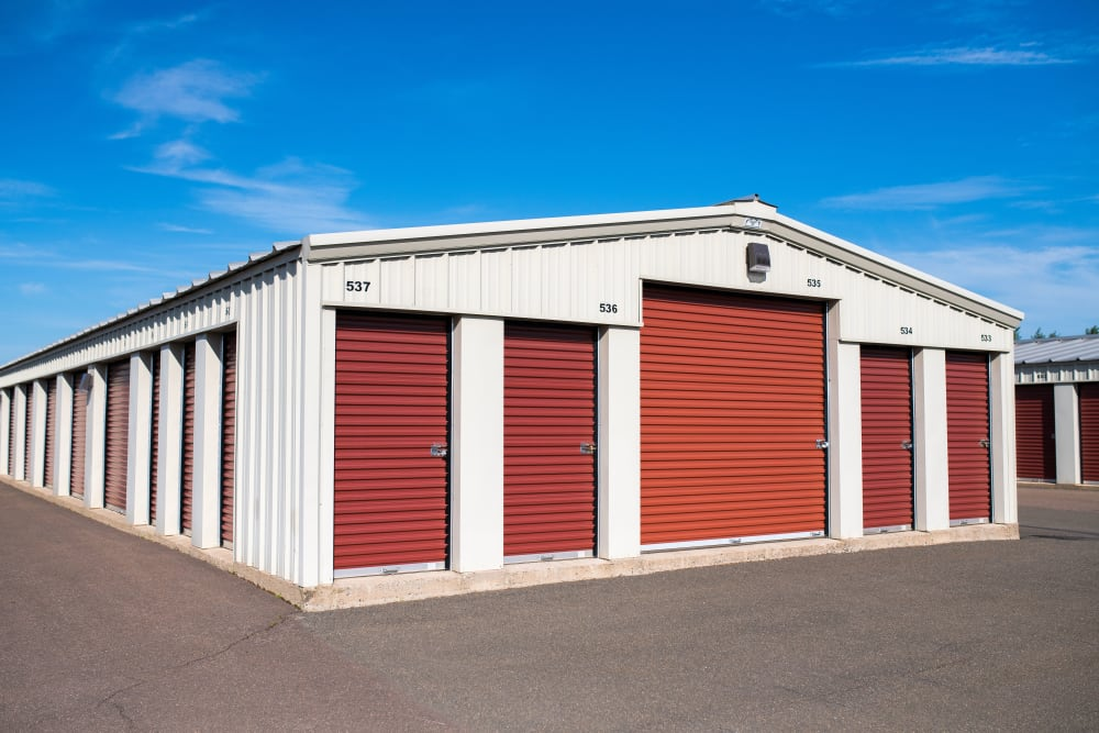 Red doors on the exterior units at Lighthouse Self Storage in Moncton, New Brunswick