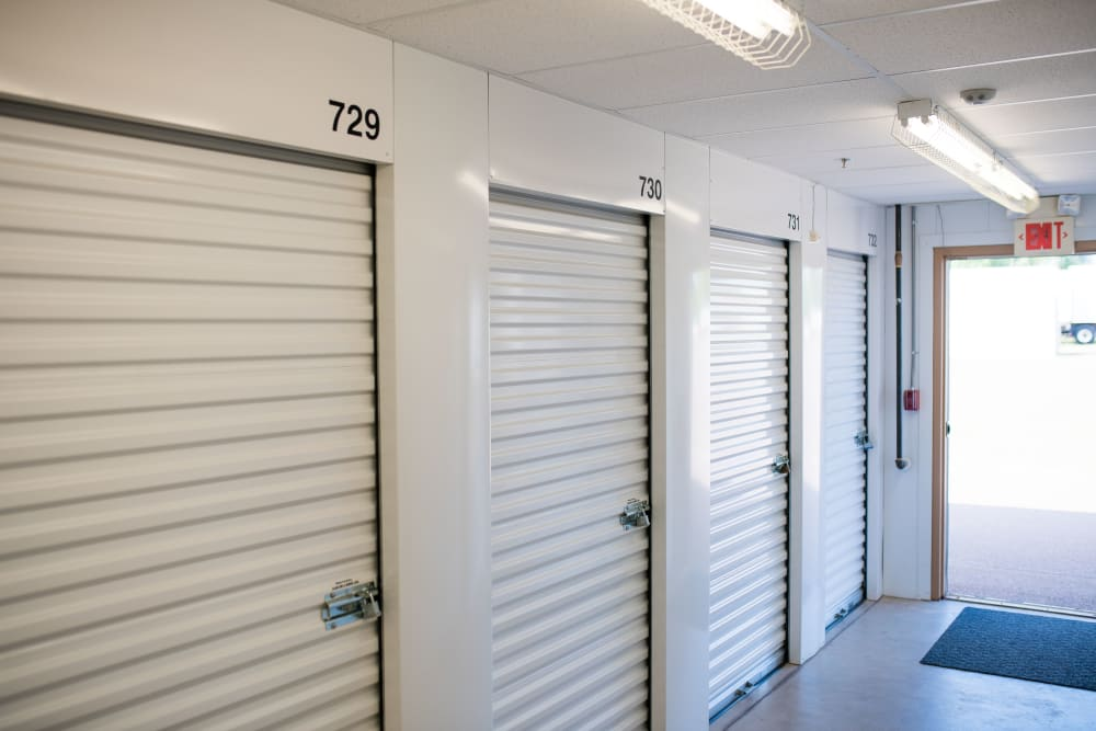 White doors on the interior storage units at Lighthouse Self Storage in Moncton, New Brunswick