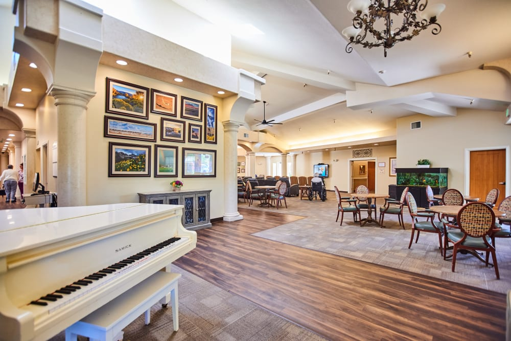 Lobby with piano at Arbors Memory Care in Sparks, Nevada