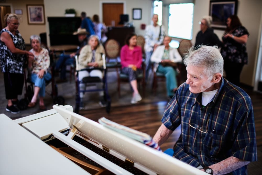 Resident playing piano at Arbors Memory Care in Sparks, Nevada