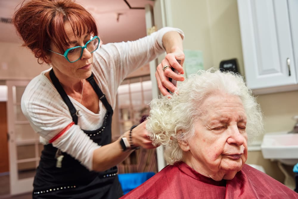 Resident getting her hair done at Arbors Memory Care in Sparks, Nevada
