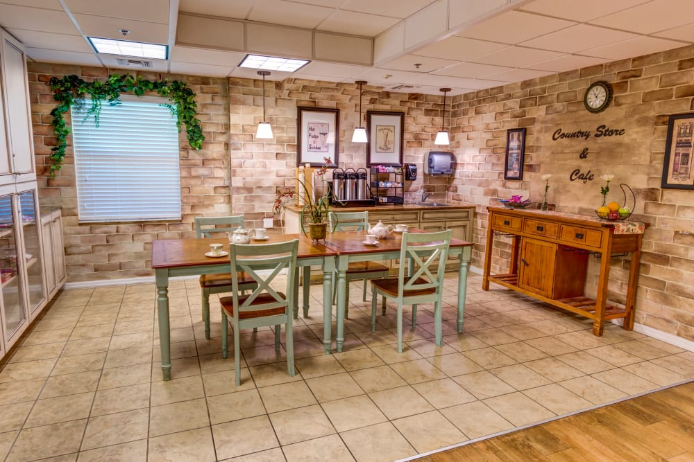 Resident dining area with cafe at Brentwood at St. Pete in St. Petersburg, Florida.