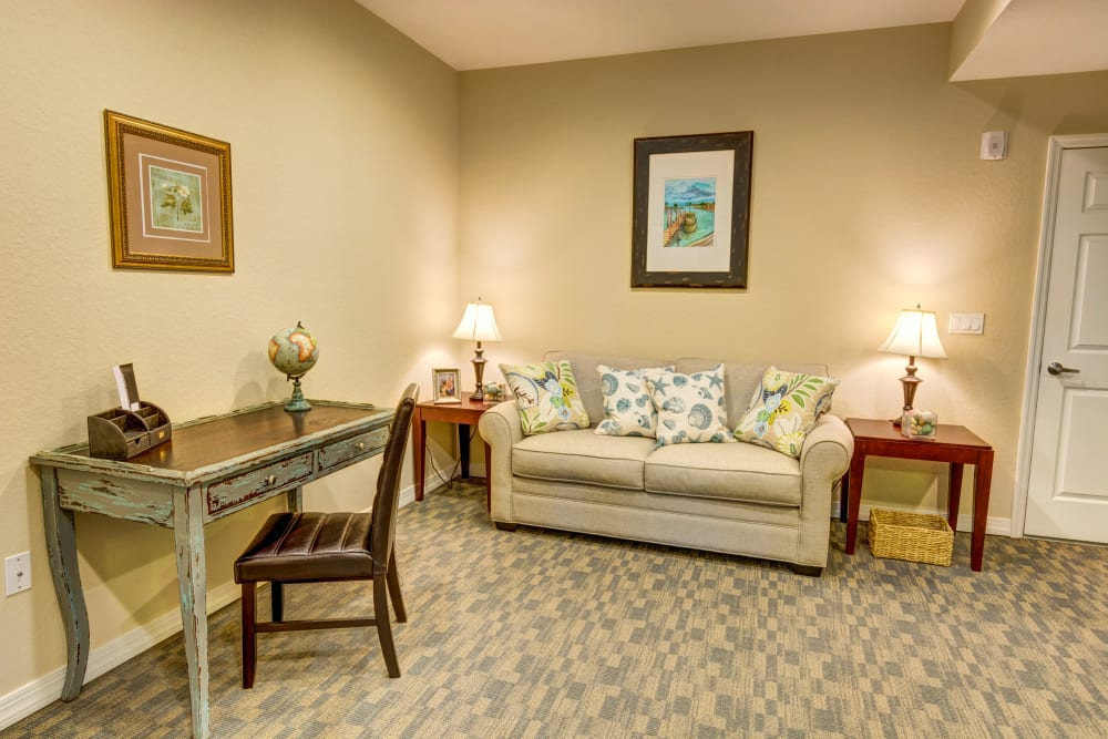 Lounge area with desk at Brentwood at St. Pete in St. Petersburg, Florida.