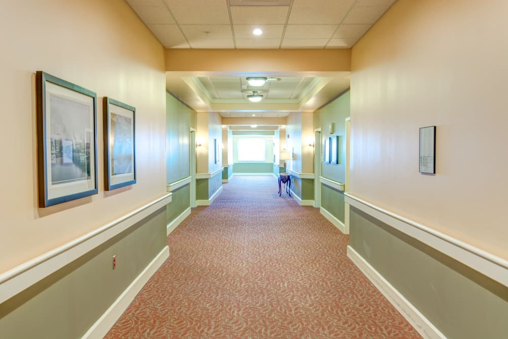 Bright, wide hallways with beautiful decor at Locust Grove Personal Care & Memory Care in West Mifflin, Pennsylvania