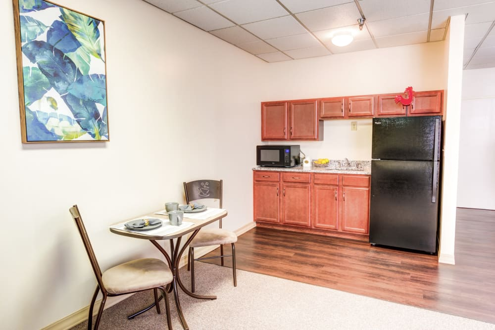 Kitchenette and dining area in model unit at Locust Grove Personal Care & Memory Care in West Mifflin, Pennsylvania