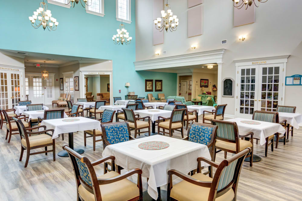 Community dining room with high ceilings at St. Augustine Plantation in Tallahassee, Florida