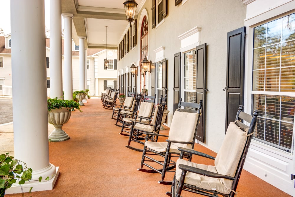 Covered porch with chairs all around at St. Augustine Plantation in Tallahassee, Florida