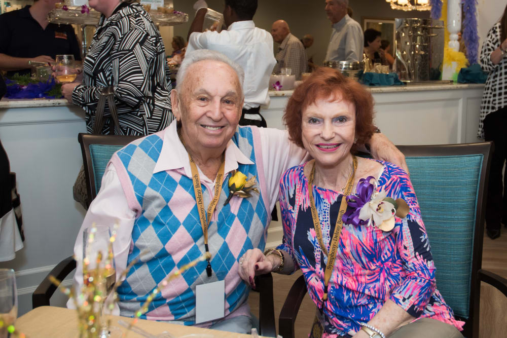 Two residents celebrating at Symphony at Delray Beach in Delray Beach, Florida.