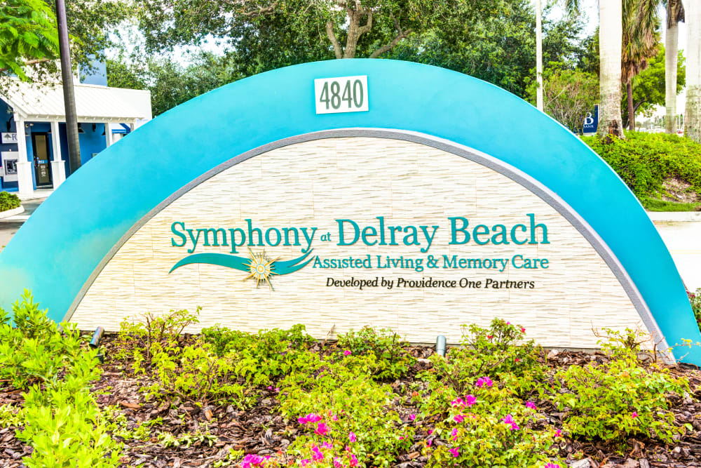 Entry sign at Symphony at Delray Beach in Delray Beach, Florida.