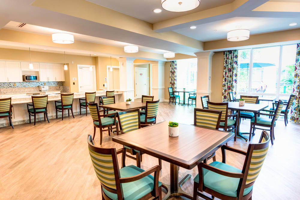 Dining room with natural light at Symphony at Delray Beach in Delray Beach, Florida.